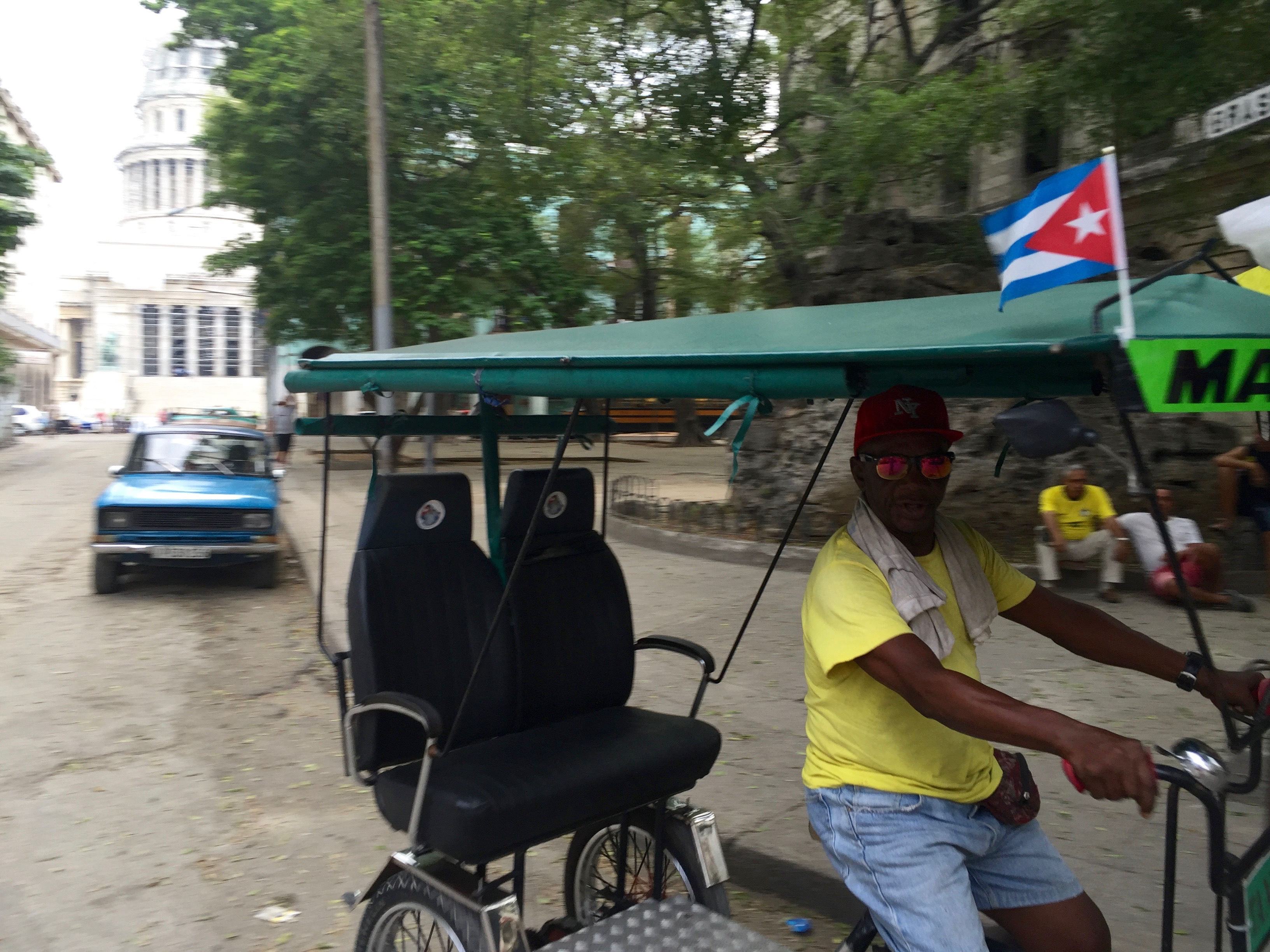Senor Martin in his bicitaxi, a common mode of transport in Havana.